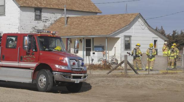 Firefighters from Imperial and Wauneta responded to a Saturday morning fire at the Wayne Bartels home, south of Enders. The fire was contained to a small section on the home's north side.